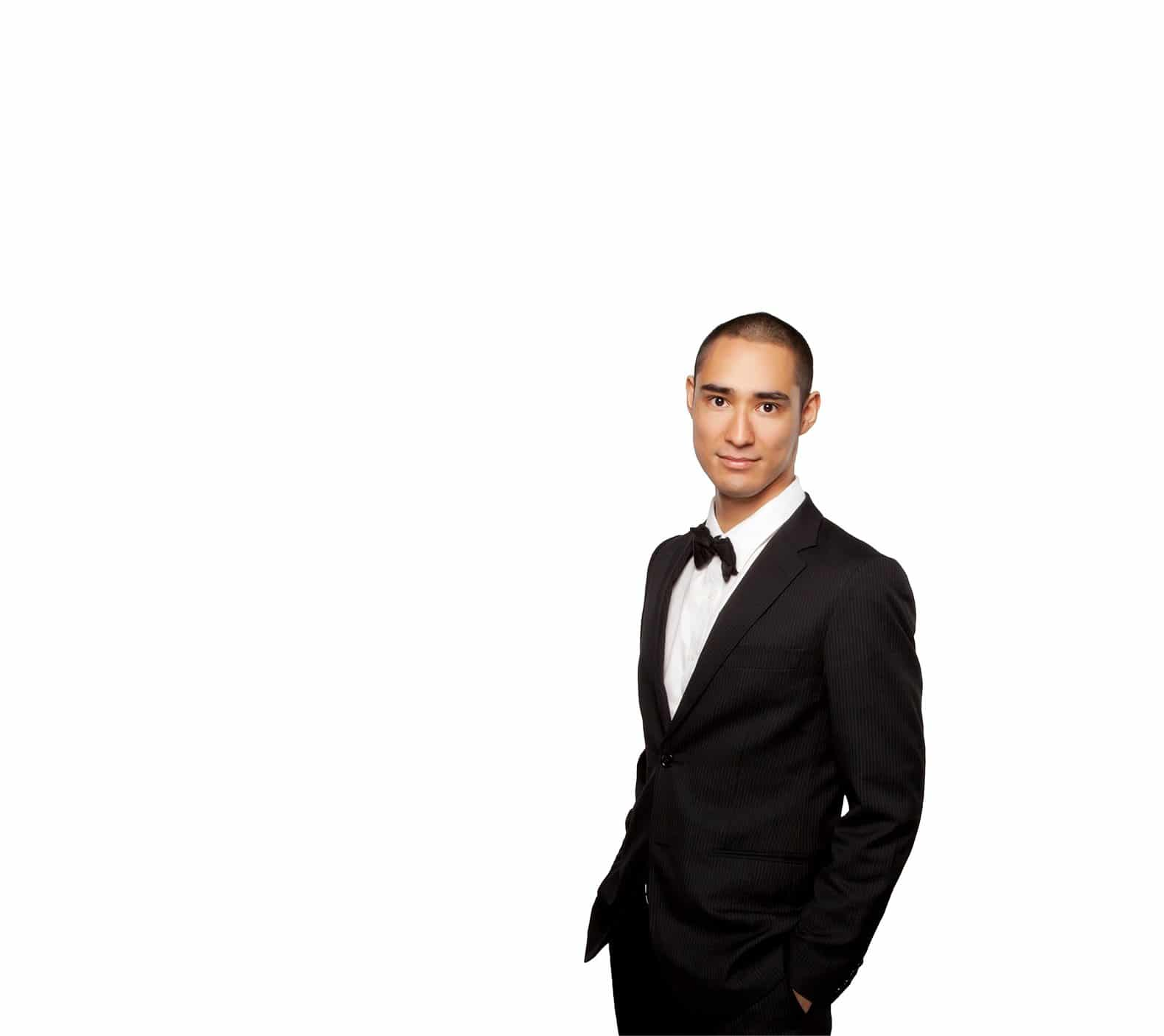 Professional man in a tuxedo with white background