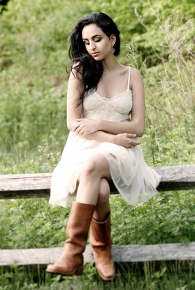 Rustic senior portrait photo with cowboy boots